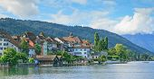 Zug, Switzerland - cityscape on a cloudy day poster