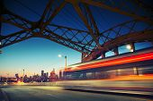 Los Angeles city at night. Long exposure shot of blurred bus speeding through iconic 6th Street Bridge poster