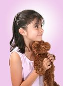 Cute girl holding teddy bear poster