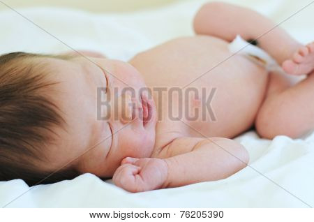 Newborn Baby With Umbilical Cord Sleeping