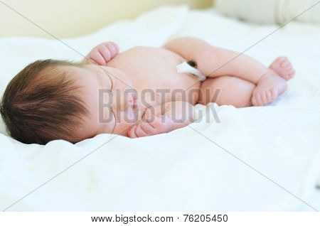 Newborn Baby With Umbilical Cord Sleeping Undressed