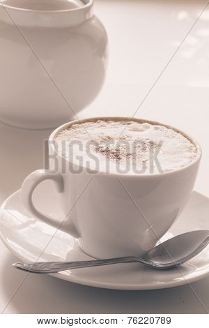 Cappuccino cup on a light background. Shallow depth of field