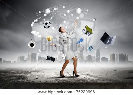 Young pretty businesswoman juggling with white balls
