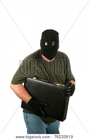 A Genuine Burglar aka Thief or Bad Guy, Robber, Stealer, Masked Man etc. wears a Black Ski Mask to hide his identity as he steals things from unsuspecting people. Isolated on white room for text