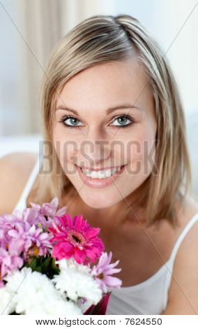 Portrait Of A Happy Woman Holding A Bunch Of Flowers