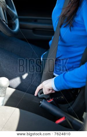 Close-up Of Caucasian Woman Putting Seat Belt