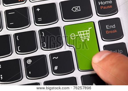 Computer keyboard key with shopping cart icon concept for e-commerce, consumerism and internet store checkout