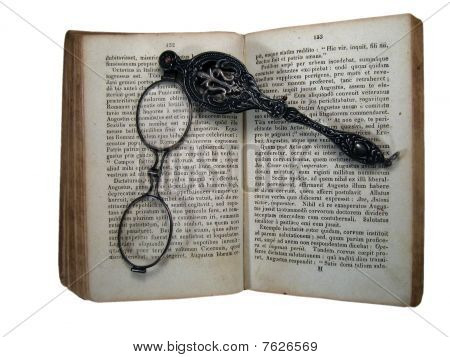 Isolated Old Latin Book And Lorgnette