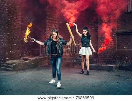 Two Women Protesters With Molotov Cocktail Bomb In The Street
