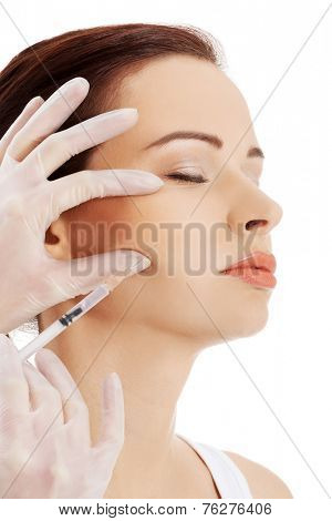 Young woman having cosmetic botox injection.