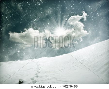 Magic winter landscape with footsteps in the snow
