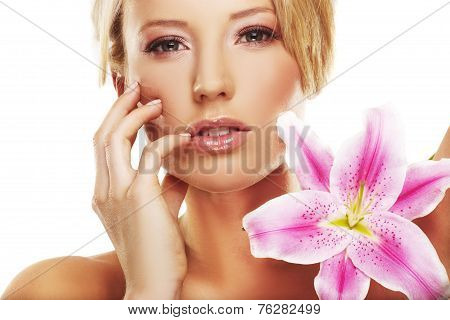 Beauty Portrait Of A Woman With A Flower