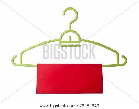Hanger. Coat Hanger With Tag On Background