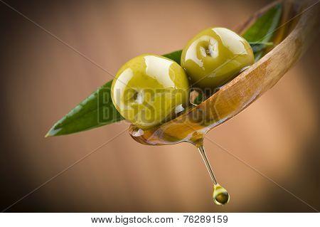 drop oil on wood spoon