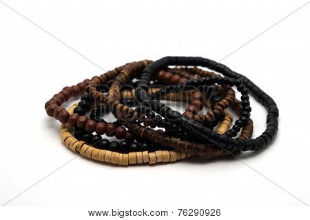 A pile of wooden Turkish bracelets