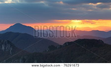 Dramatic Sunset Rays Behind Silhouette Of Of Mountain