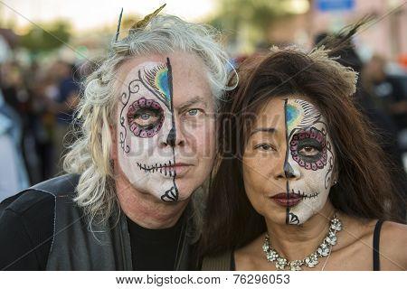 Couple In Dia De Los Muertos Makeup