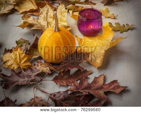 Glass Candle Holder With Burning Candle And Pumpkin