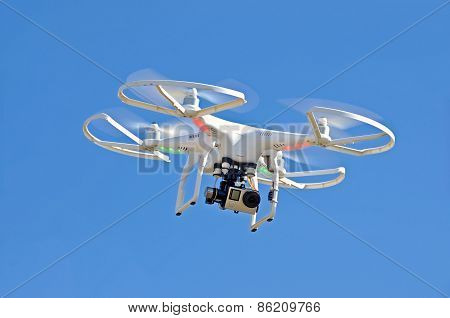 white drone in blue sky