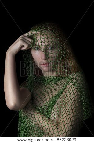 woman posing caught in the net and thinking