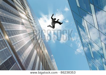 Man Jumping Over The Roof
