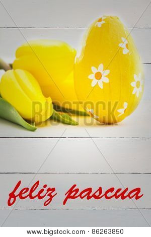 feliz pasqua against yellow easter egg with yellow tulips