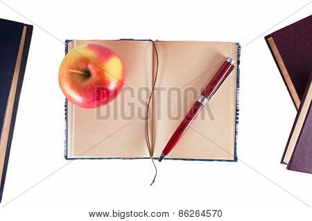 Notebook With Pen And Apple
