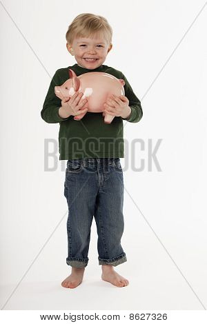 Little Boy Holding a Piggy Bank
