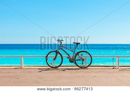 Bicycle on famous Promenade des Anglais as Mediterranean sea on background in Nice, France.