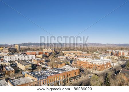 FORT COLLINS, CO, USA - MARCH 21, 2015: Aerial view of Fort Collins downtown,  early spring scenery with Front Range of ROcky Mountains in background