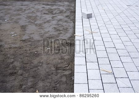 Installing Paver Bricks On Patio During Construction Works