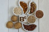 Foods containing vitamin B6: oatmeal buckwheat barley raisins potatoes walnuts hazelnuts poster