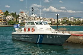 Coast Guard Boat Docked At A Port.