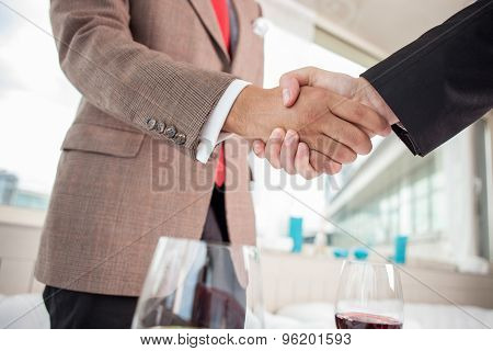 Young business partners have an appointment in restaurant