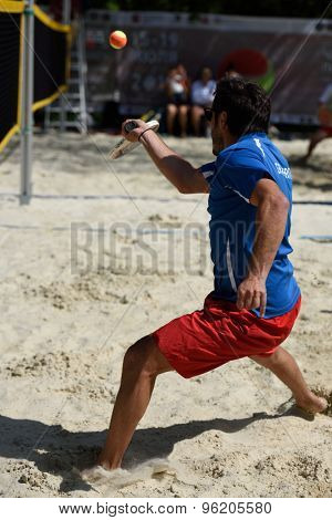 MOSCOW, RUSSIA - JULY 15, 2015: Yiannis Toumazis of Great Britain in action during the ITF Beach Tennis World Team Championship. 28 nations compete in the event this year