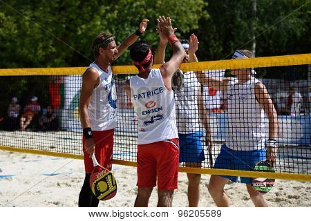 MOSCOW, RUSSIA - JULY 15, 2015: Men doubles of France and Israel greeting one another after the match during the ITF Beach Tennis World Team Championship. 28 nations compete in the event this year