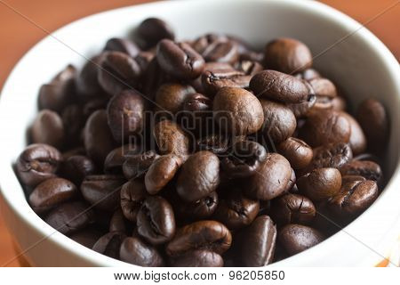 Coffee Beans Placed In A Cup