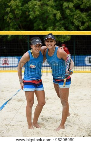 MOSCOW, RUSSIA - JULY 15, 2015: Marie-Eve Hoarau (left) and Mathilde Hoarau of France during the ITF Beach Tennis World Team Championship. 28 nations compete in the event this year