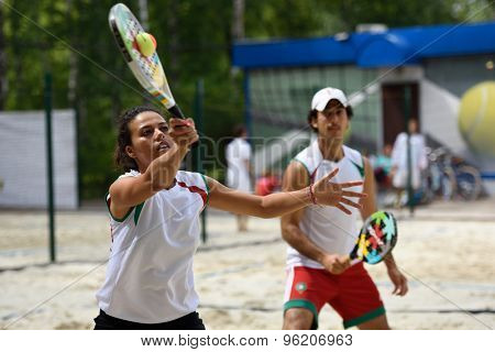 MOSCOW, RUSSIA - JULY 15, 2015: Selma Hidass (left) and Adil Medina of Morocco in action during the ITF Beach Tennis World Team Championship. Morocco first time competes in the event