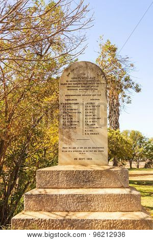 """Nieuwoudtville, South Africa - May 5, 2015: """"Skuldmonument"""" (""""Debt Monument"""") outside the Dutch Reformed Church in Nieuwoudtville South Africa"""