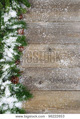 Christmas Border With Snow Covered Evergreen Branches On Rustic Wooden Boards