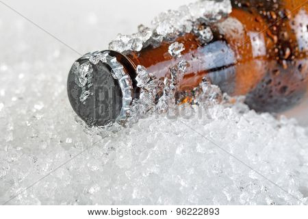 Close Up View Of An Ice Cold Beer Bottle Neck And Cap