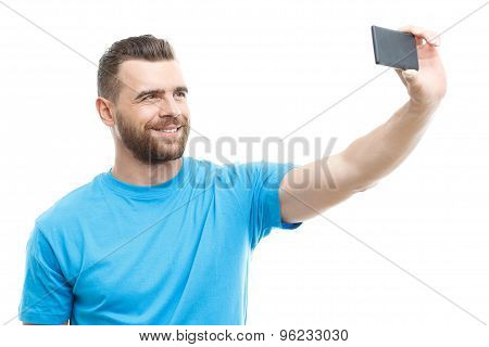 Man with beard doing selfie