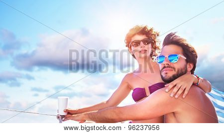 Beautiful young family spending hot summer days on the sailboat, traveling along sea, romantic relationship, enjoying honeymoon poster