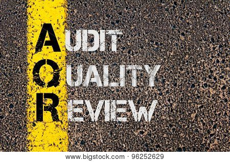 Concept image of Business Acronym AQR as Audit Quality Review written over road marking yellow paint line. poster