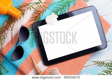 beach background with a blank tablet