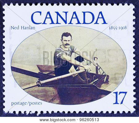 Man with mustache in a canoe on a stamp