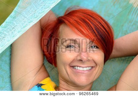 Adult Woman Relaxing On Hammock At The Garden