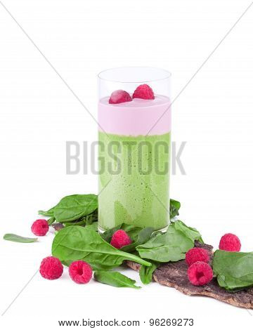 green smoothie with raspberries on white background
