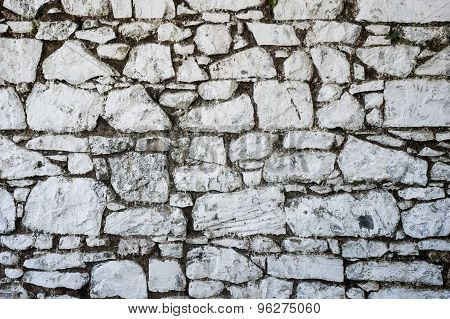 old grungy whitewash traditional stone wall in Ireland